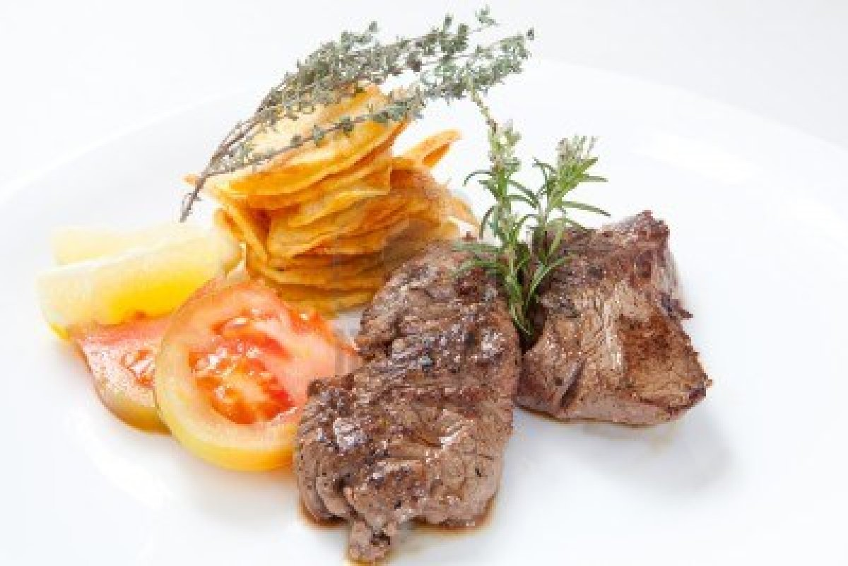 8697655-two-juicy-beef-steak-with-chips-and-herbs